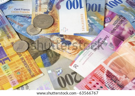 swiss francs notes and bucks - stock photo