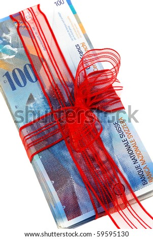 Swiss francs with a red bow gift of money - stock photo