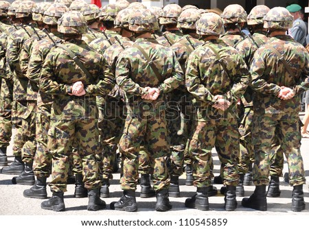 Swiss military men - stock photo