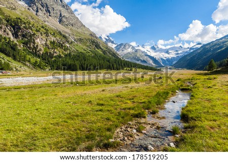 Swiss mountain landscape of the Morteratsch Glacier Valley hiking trail in the Bernina Mountain Range of the Bundner Alps. - stock photo