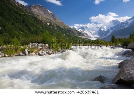 Swiss mountain landscape of the Morteratsch Glacier Valley hiking trail in the Bernina Mountain Range - stock photo