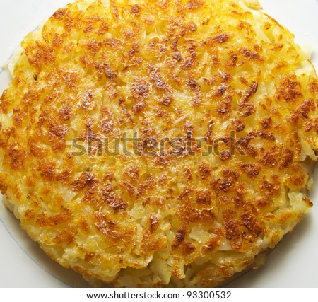 Swiss Roesti on a plate - stock photo
