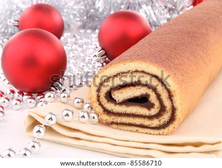 swiss roll and christmas decoration - stock photo