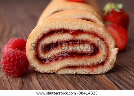 swiss roll and fruit - stock photo