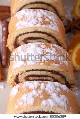 swiss roll, slice of chocolate cake - stock photo