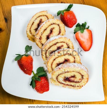 swiss roll with strawberry jam - stock photo