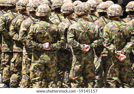 Swiss solders in camouflage - stock photo