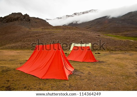Swiss tents at a campsite near Chandertal lake in Himalaya mountain valley