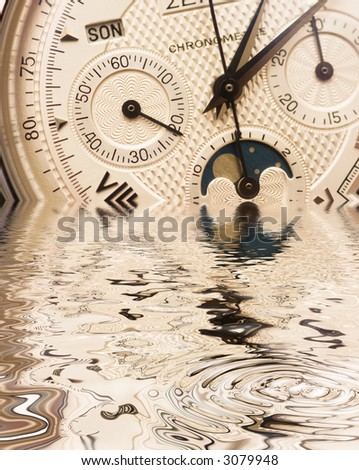Swiss watch close up with reflection on water - stock photo