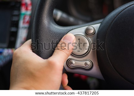 switch control on steering wheel with hand selection focus