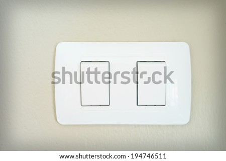 switch electrically on the wall - stock photo