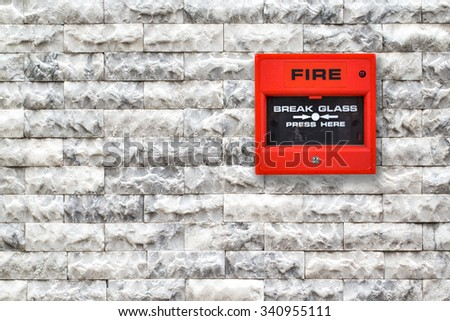 Switch fire alarm on the marble. - stock photo