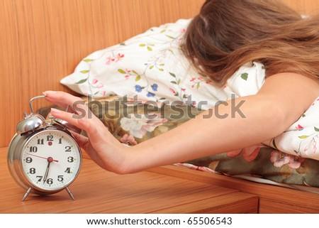 switch off an alarm clock - stock photo
