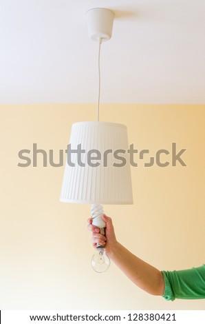 Switch on energy saving - stock photo