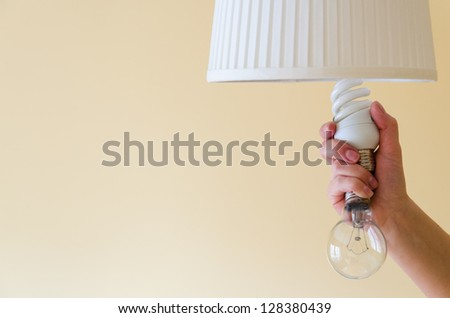Switch on energy saving - stock photo