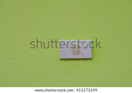 Switch on the green wall - stock photo