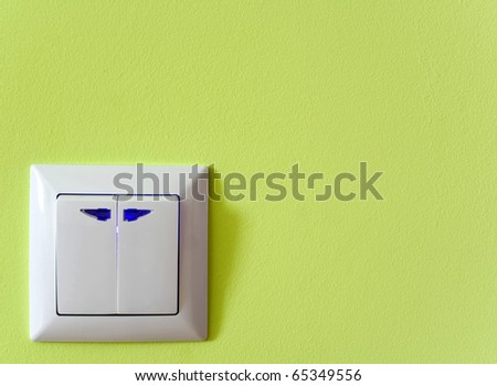 switch outlet on green baskgrounds - stock photo