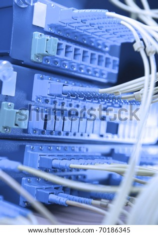 switch with network cables and servers in a technology data center - stock photo