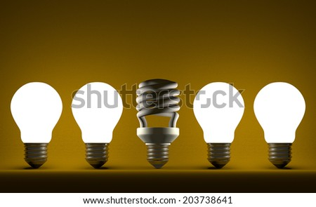 Switched off fluorescent light bulb in row of glowing incandescent ones on yellow textured background