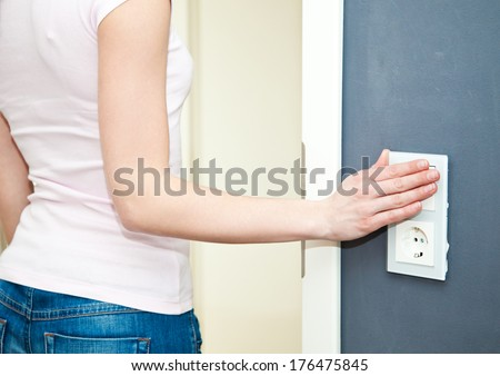 Switching off the light - stock photo