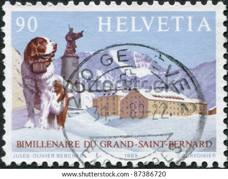 SWITZERLAND - CIRCA 1989: A stamp printed in Switzerland, depicts St. Bernard dog, statue of saint, hospice on summit, circa 1989