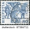 SWITZERLAND - CIRCA 1977: A stamp printed in Switzerland, is depicted Griffins, Basel, circa 1977 - stock photo