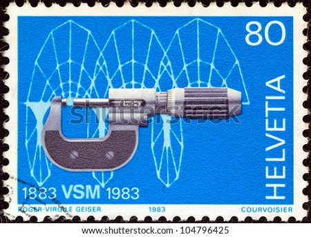 SWITZERLAND - CIRCA 1983: A stamp printed in Switzerland issued for the centenary of Swiss machine manufacturers' association shows Micrometer and cycloidal computer drawing, circa 1983.