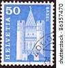 SWITZERLAND - CIRCA 1960:  A stamp printed in Switzerland shows a drawing of the Spalen Gate in Basel, Switzerland, circa 1960. - stock photo