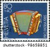 SWITZERLAND - CIRCA 1985: A stamp printed in Switzerland, shows a folk instrument Diatonic accordion, 20th century, circa 1985 - stock photo