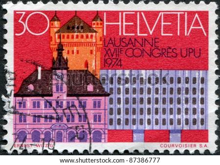 SWITZERLAND - CIRCA 1974: A stamp printed in Switzerland, shows Castle, Town Hall, Chauderon Center, Lausanne, circa 1974 - stock photo