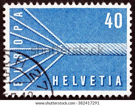 SWITZERLAND - CIRCA 1957: a stamp printed in Switzerland shows Rope and Symbol of European Unity, circa 1957 - stock photo