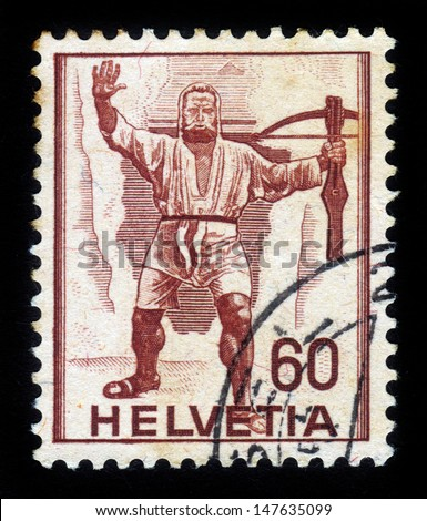 SWITZERLAND - CIRCA 1949: A stamp printed in Switzerland shows Wilhelm ( william ) Tell, folk hero, circa 1949 - stock photo