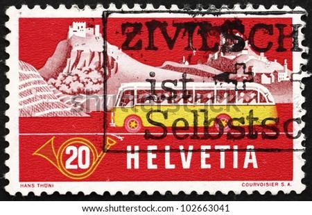 SWITZERLAND - CIRCA 1953: a stamp printed in the Switzerland shows Alpine Post Bus, Summer Background, circa 1953 - stock photo