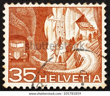 SWITZERLAND - CIRCA 1949: a stamp printed in the Switzerland shows Alpine Postal Road, circa 1949 - stock photo