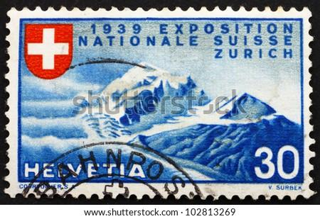 SWITZERLAND - CIRCA 1939: a stamp printed in the Switzerland shows Alpine Scenery, National Exposition of 1939, Zurich, circa 1939 - stock photo