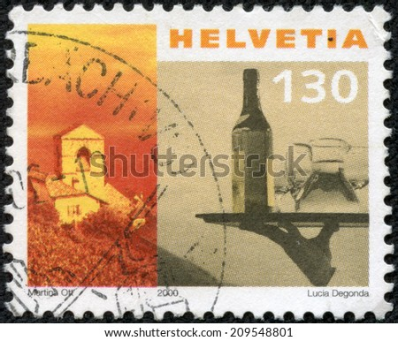 SWITZERLAND - CIRCA 2000: a stamp printed in the Switzerland shows Church of St. Saphorin and Waiter's Tray, circa 2000 - stock photo