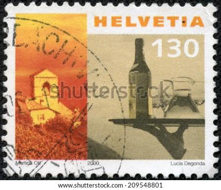 SWITZERLAND - CIRCA 2000: a stamp printed in the Switzerland shows Church of St. Saphorin and Waiter's Tray, circa 2000 - stock photo