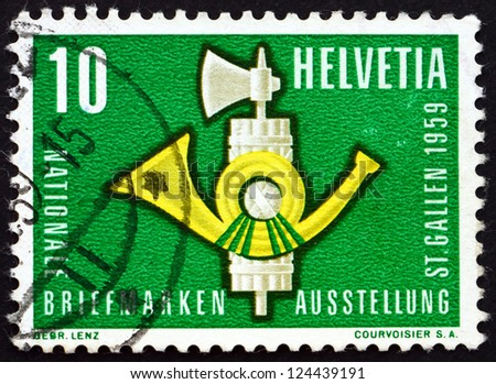 SWITZERLAND - CIRCA 1959: a stamp printed in the Switzerland shows Fasces and Post Horn, National Philatelistic Exhibition, St. Gall, circa 1959 - stock photo