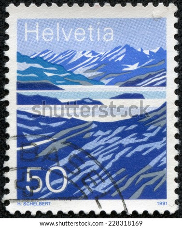 SWITZERLAND - CIRCA 1991: a stamp printed in the Switzerland shows Mountain Lakes, Switzerland, circa 1991 - stock photo