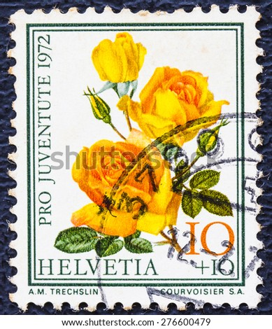 SWITZERLAND - CIRCA 1972: a stamp printed in the Switzerland shows Pro Juventute Roses , circa 1972 - stock photo