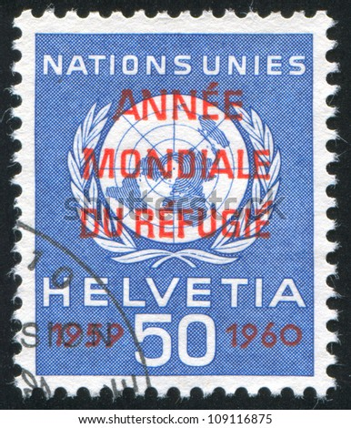 SWITZERLAND - CIRCA 1959: stamp printed by Switzerland, shows Nations Emblem, circa 1959