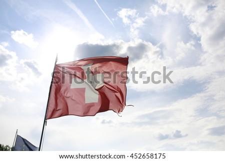 switzerland confederation helvetica flag at wind - stock photo