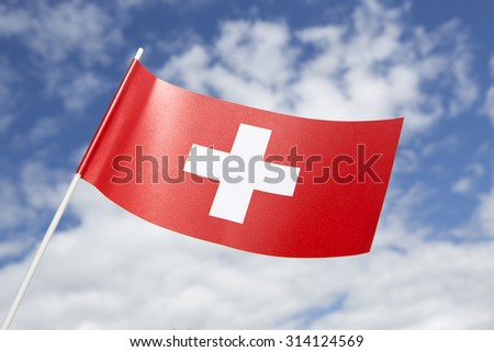 Switzerland flag in front of a blue sky - stock photo