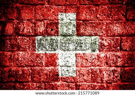 Switzerland flag painted on old brick wall  - stock photo