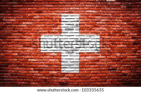 switzerland flag painted on old brick wall texture background