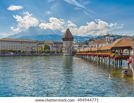 Switzerland, Lucerne - September 3, 2016: View of Lucerne with bridge kapellbrücke, Wasserturm Tower.