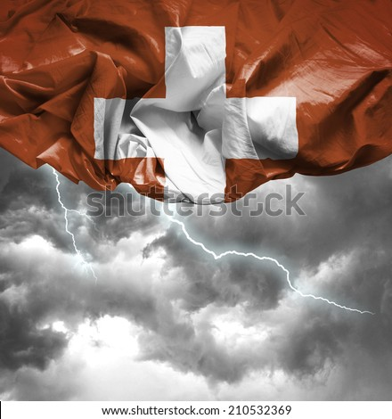 Switzerland waving flag on a bad day - stock photo