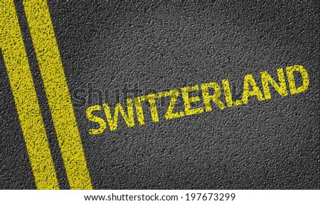 Switzerland written on the road - stock photo