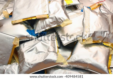 Swollen lithium ion polymer batteries - toxic dangerous waste - stock photo