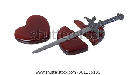Sword and a Broken Red glass heart symbolizing a broken heart over a failed romance - path included - stock photo